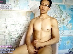 Asian boy eats his own cum
