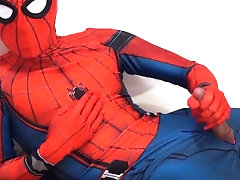 Horny spiderman masturbates, shoots web.