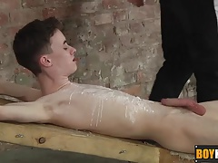 Tyler sucks and masturbates his big cock after dripping wax