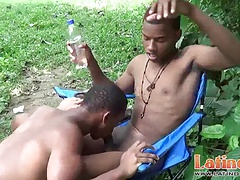 Horny brown gay Latinos give a blowjob outdoors