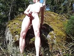 Boy masturbates outside in morning sun