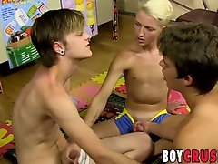 Cock sucking twinks having fun with a dildo in threeway