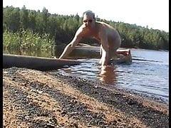 Humping naked a big hose at the lakeshore