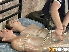 Dominant male jerks off his wrapped up twinks