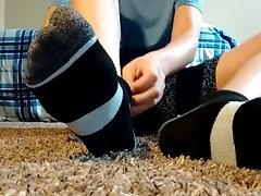Boy shows smooth feet