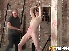 Master Sebastian jerking his restrained submissive off