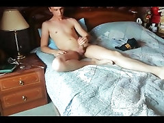 young guy masturbates in his bed