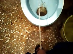 college teenager pissing in public toilet