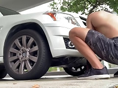 Hidden camera catches sexy muscle twink washing his car on New Years 2020