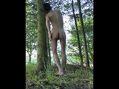 Teen masturbates in the woods